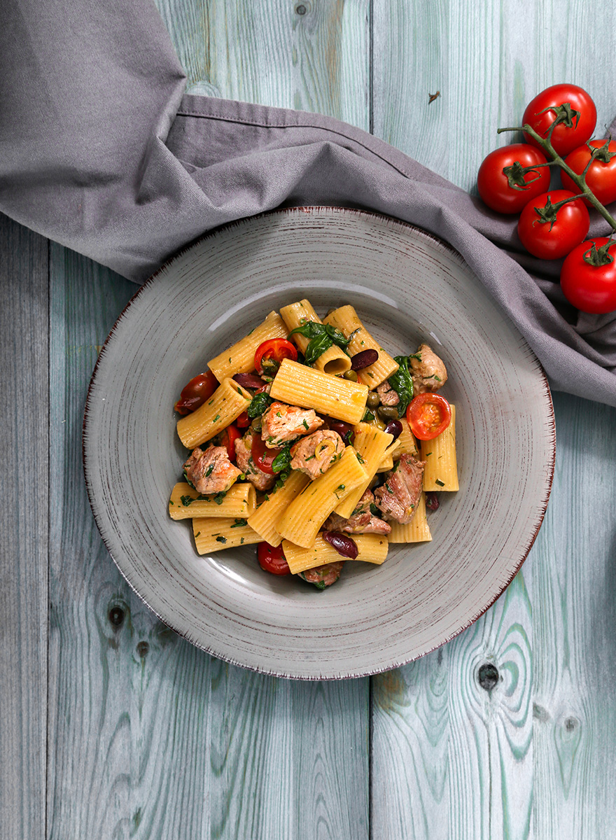 Rigatoni with pork neck En Elladi, olives, cherry tomatoes and katiki
